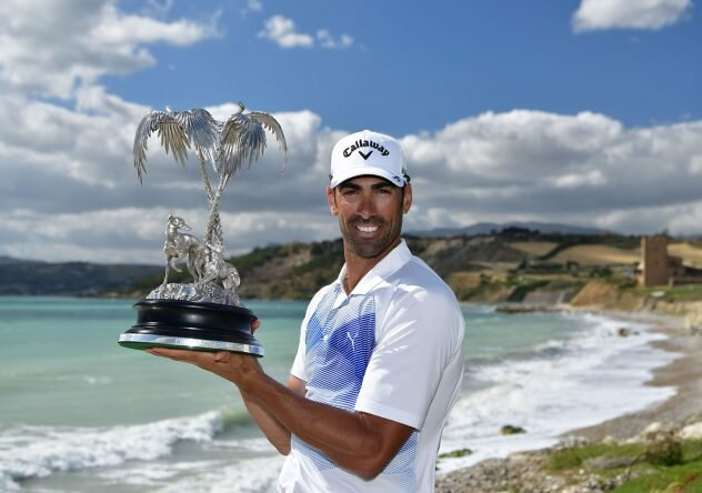 Alvaro Quiros of Spain holds the trophy after winning The Rocco Forte Open at The Verdura Golf and Spa Resort. © Getti Images | Stuart Franklin