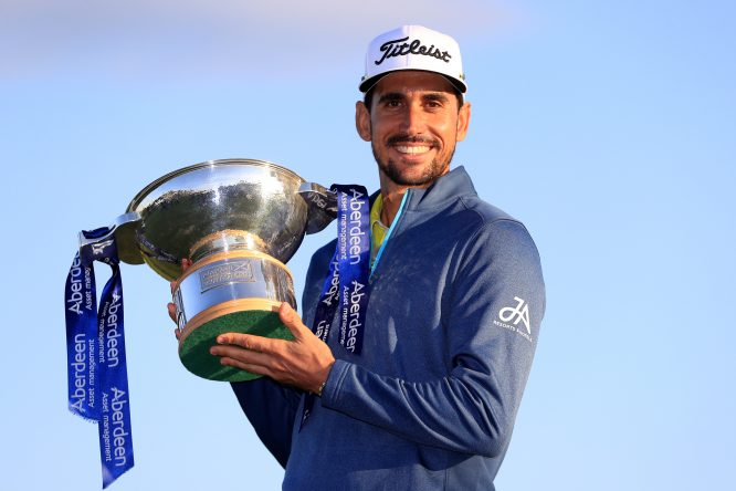 Rafa Cabrera Bello of Spain poses with the trophy following his victory on the 1st play off hole during the final round of the AAM Scottish Open at Dundonald Links Golf Course on July 16, 2017 in Troon, Scotland. (Photo by Andrew Redington/Getty Images)