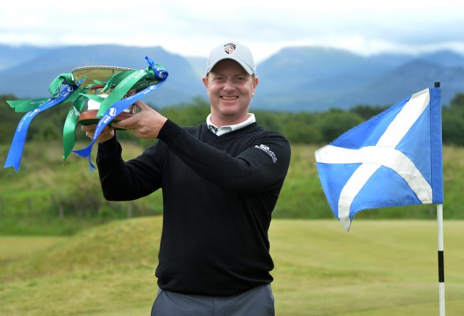 Richard McEvoy of England poses with the trophy after winning the 2017 SSE Scottish Hydro Challenge hosted by MacDonald Hotels and Resorts. at Spey Valley Golf Course on July 2, 2017 in Aviemore, Scotland. (Photo by Mark Runnacles/Getty Images)