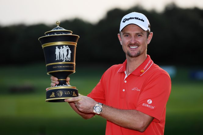 Justin Rose of England celebrates with the Old Tom Morris Cup after finishing 14 under to win the WGC - HSBC Champions at Sheshan International Golf Club on October 29, 2017 in Shanghai, China. (Photo by Ross Kinnaird/Getty Images)