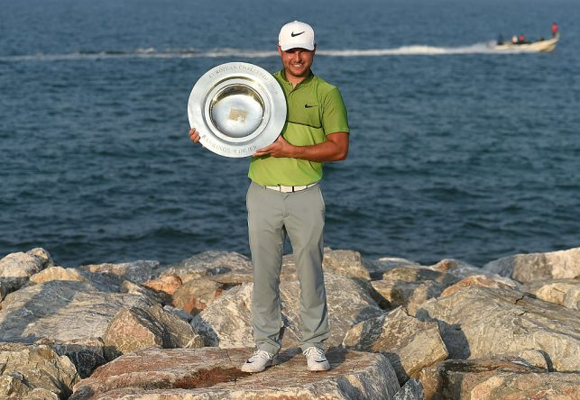 Jordan Smith of England poses with the Road to Oman Rankings trophy on day four of the NBO Golf Classic Grand Final at Al Mouj Golf on November 5, 2016 in Muscat, Oman. (Photo by Tom Dulat/Getty Images)