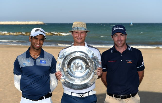 Aaron Rai of England, Tapio Pulkkanen of Finland and Julien Guerrier of France pose with the trophy prior to the NBO Golf Classic Grand Final - European Challenge Tour at Al Mouj Golf on October 30, 2017 in Muscat, Oman. (Photo by Tom Dulat/Getty Images)
