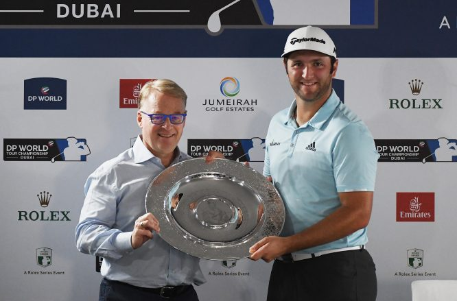 Jon Rahm of Spain is presented with the Rookie of the Year award by European Tour Chief Executive Keith Pelley during the Pro-Am prior to the DP World Tour Championship at Jumeirah Golf Estates on November 14, 2017 in Dubai, United Arab Emirates. (Photo by Ross Kinnaird/Getty Images)