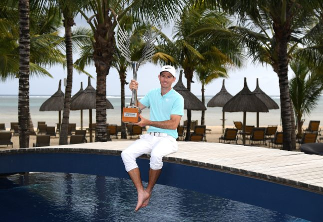 BEL OMBRE, MAURITIUS - DECEMBER 03: Dylan Frittelli of South Africa holds the trophy as he celebrates victory during day four of the AfrAsia Bank Mauritius Open at Heritage Golf Club on December 3, 2017 in Bel Ombre, Mauritius. (Photo by Ross Kinnaird/Getty Images)