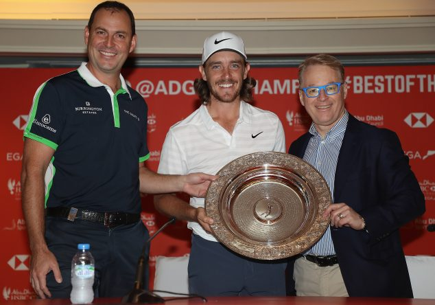 David Howell (L), European Tour Tournament Commitee, and Keith Pelley (R), CEO of the PGA European Tour present Tommy Fleetwood of England with the 'Seve Ballesteros Award' which is voted for by the players ahead of the Abu Dhabi HSBC Golf Championship at Abu Dhabi Golf Club on January 16, 2018 in Abu Dhabi, United Arab Emirates. (Photo by Matthew Lewis/Getty Images)
