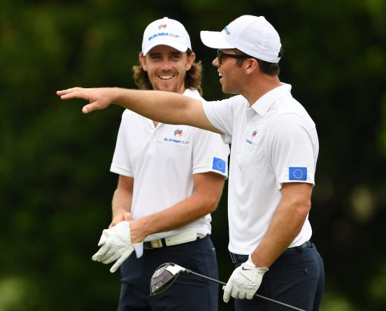 Paul Casey gestures to Tommy Fleetwood of Team Europe during practice prior to the start of the Eurasia Cup at Glenmarie G&CC on January 10, 2018 in Kuala Lumpur, Malaysia. (Photo by Stuart Franklin/Getty Images)