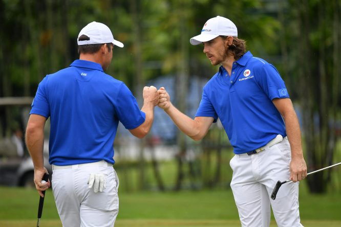 Tommy Fleetwood celebrates with Paul Casey of Europe during the fourballs matches on day one of the 2018 EurAsia Cup presented by DRB-HICOM at Glenmarie G&CC on January 12, 2018 in Kuala Lumpur, Malaysia. (Photo by Stuart Franklin/Getty Images)