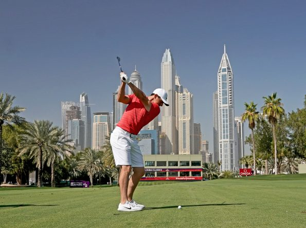 Rory McIlroy of Northern Ireland plays a short iron shot (part of swing sequence frame 4) as a preview for the Omega Dubai Desert Classic on the Majlis Course at The Emirates Golf Club on January 23, 2018 in Dubai, United Arab Emirates. (Photo by David Cannon/Getty Images)