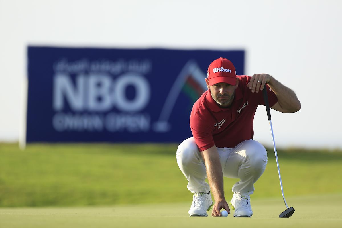 Paul Waring durante la primera ronda en el Al Mouj Golf. © Golffile | Phil Inglis
