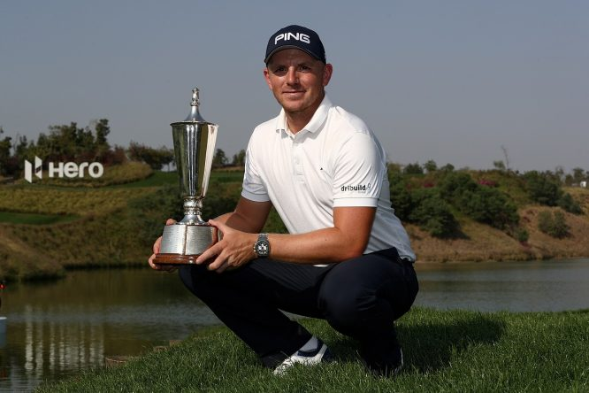 Matt Wallace of England poses for a picture with the trophy after winning the play off during day four of The Hero Indian Open at Dlf Golf and Country Club on March 11, 2018 in New Delhi, India. (Photo by Matthew Lewis/Getty Images)