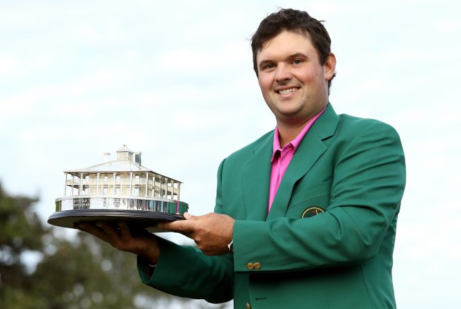 Patrick Reed of the United States celebrates with the trophy during the green jacket ceremony after winning the 2018 Masters Tournament at Augusta National Golf Club on April 8, 2018 in Augusta, Georgia. (Photo by Jamie Squire/Getty Images)