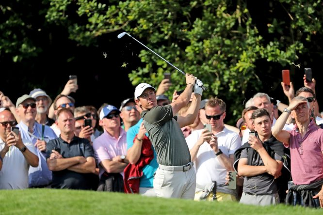 Rory McIlroy of Northern Ireland plays his second shot on the par 5, 18th hole during the third round of the 2018 BMW PGA Championship on the West Course at Wentworth on May 26, 2018 in Virginia Water, England. (Photo by David Cannon/Getty Images)