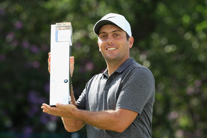 Francesco Molinari of Italy holds the trophy after winning the BMW PGA Championship at Wentworth on May 27, 2018 in Virginia Water, England. (Photo by Andrew Redington/Getty Images)