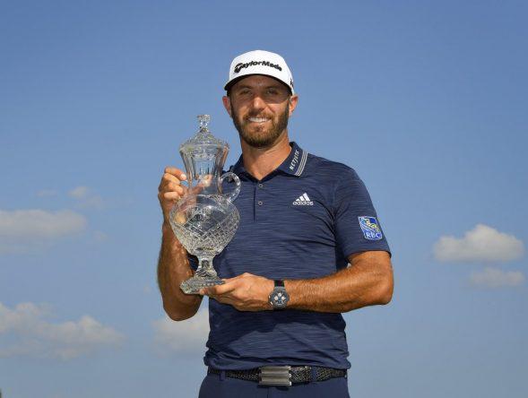 Dustin Johnson con el trofeo de ganador del FedEx St. Jude Classic. © PGA Tour