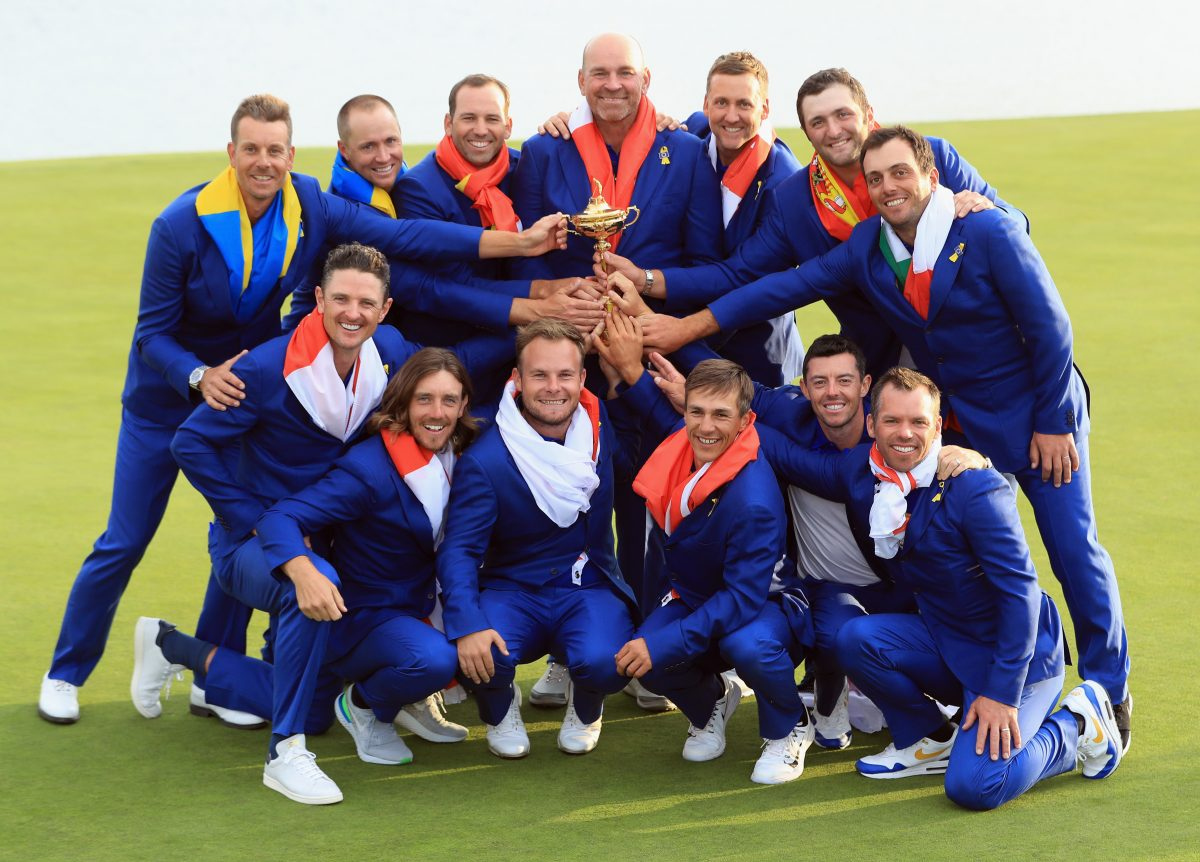 Captain Thomas Bjorn of Europe holds The Ryder Cup trophy as The European Team celebrate victory following the singles matches of the 2018 Ryder Cup at Le Golf National on September 30, 2018 in Paris, France. © Getty Images