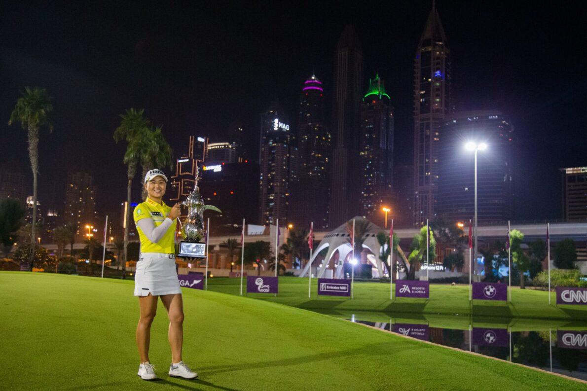 Minjee Lee poses against Dubai skyline.