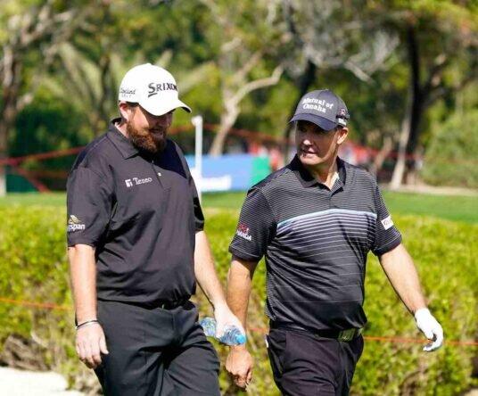 Shane Lowry y Padraig Harrington en la ronda de prácticas del martes del Abu Dhabi HSBC Championship. © Golffile | Eoin Clarke
